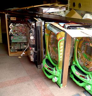 Pachinko - The inside workings of a pachinko machine being pulled out of a parlor.