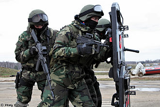 U.S. Woodland - Russian Internal Troops wearing LES, a Russian camouflage pattern similar to the BDU's camouflage