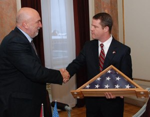Ivars Godmanis - Godmanis (left) greets Ambassador Chuck Larson of the United States, January 2009