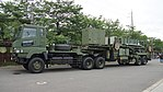 JASDF MIM-104 Patriot PAC-2 7t Tractor(Mitsubishi Fuso Super Great, 49-2211) with M901 Launching Station(49-3140) left front view at JMSDF Maizuru Naval Base July 29, 2017 03.jpg