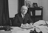 James Francis Byrnes, at his desk, 1943.jpg