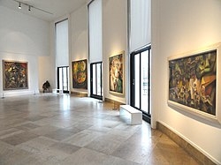 Jean Metzinger, L'Oiseau Bleu (left), André Lhote, two works (center), Albert Gleizes, Baigneuse (right), Musée d'Art Moderne de la Ville de Paris.jpg