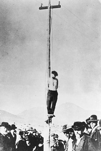 Lynching in the United States - John Heath's corpse hanging from a pole in Arizona after being lynched on February 22, 1884.