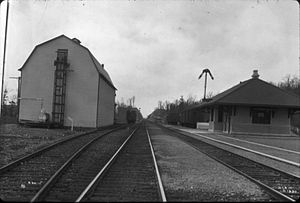 Johnsonburg (DL&W station) - Johnsonburg Station (right) and creamery in 1911. In the distant background is Armstrong Cut, where a 1941 landslide closed the Cut-Off for a month and led to the trimming of the cut's north (right) side.