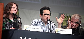 Star Wars: The Force Awakens - From left to right: producer Kathleen Kennedy, writer and director J. J. Abrams, and writer Lawrence Kasdan speaking at San Diego Comic-Con 2015