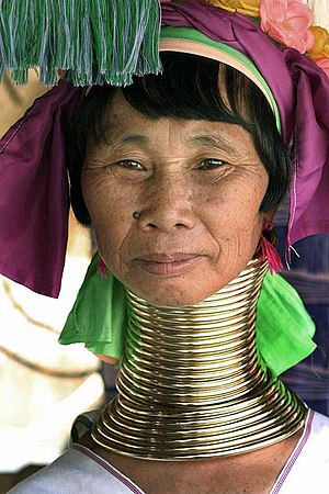 Neck ring - A photo of a Kayan woman that is wearing neck rings