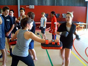 English: girls kickboxing in pe