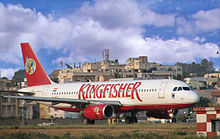 "Airport terminal with aeroplane labelled ""Kingfisher"""