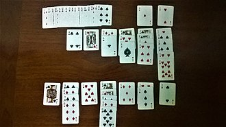 Klondike (solitaire) - A lost game of Klondike. The stock is shown at the upper-left. The upper section of the Tableau shows downturned cards, and the lower section shows the upturned cards. Except the 2♥, no cards can be moved.