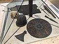 Kulturhistorisk Museum, Oslo, Norway. Medieval weapons (skull,12c. sword, battle axe, 13c. helmet, 14c. shield, 15c. dagger, spear point, quiver, crossbow arrow, arrowheads, chain mail) 2017-12-14 b.jpg