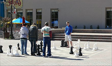 Playing Chess on the Strand Lets Play Chess Strand Galveston.jpg