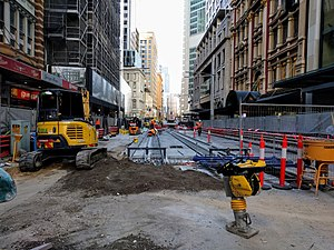 CBD and South East Light Rail - Construction views. and Alison Road, Randwick in December 2016 (left) and George Street in front of the Dymocks Building in July 2017 (right)