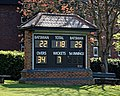 Loughton Cricket Club ground scoreboard at Loughton, Essex, England.jpg
