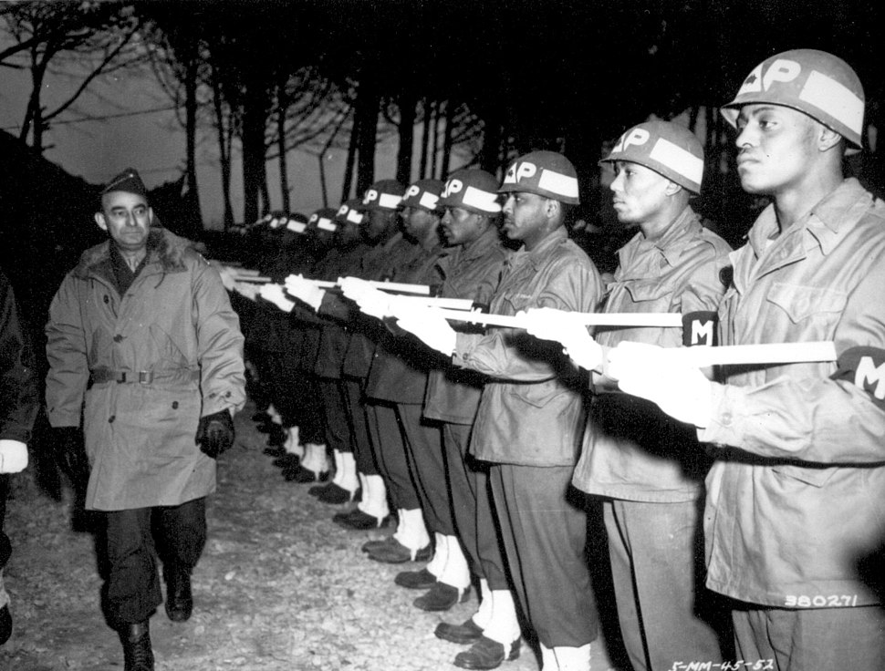 Lt. Gen. Joseph T. McNarney, Deputy Supreme Allied Commander, Mediterranean Theater, inspects Honor Guard of MPs during his tour of the Fifth Army front at the 92nd Division Sector