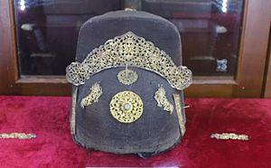 Vietnamese clothing - 19th century Phốc Đầu cap, with ornamented gold Kim Bác Sơn.