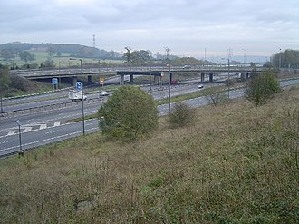 M1 at Junction 4. The old overhead lane control gantries are still visible, which were replaced with newer, verge-mounted MS4 variable message signs in 2008. M1 Motorway, Junction 4 - geograph.org.uk - 85978.jpg