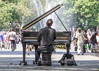 Placemaking - A pianist makes use of a public piano, effectively adding to the sense of place of Washington Square Park, Manhattan, New York.