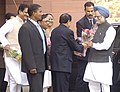 Manmohan Singh being welcomed by the Union Minister for Information & Broadcasting and Parliamentary Affairs, Shri Priyaranjan Dasmunsi on his arrival to attend the first day Budget Session of the Parliament, in New Delhi.jpg