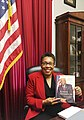 Marcia Fudge holding a copy of Jim Clyburn's book Blessed Experiences.jpg