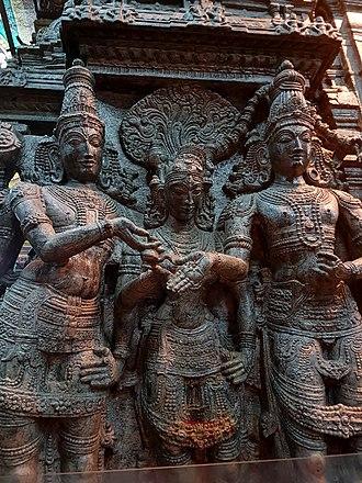 Architecture of Tamil Nadu - Mariage of Shiva and Parvati (Meenakshi) witnessed by Vishnu, Meenakshi Temple, Madurai