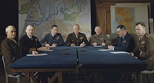 Supreme Headquarters Allied Expeditionary Force - SHAEF commanders at a conference in London Left to right: Lieutenant General Omar N. Bradley, Admiral Sir Bertram Ramsay, Air Chief Marshal Sir Arthur Tedder, General Dwight D. Eisenhower, General Sir Bernard Montgomery, Air Chief Marshal Sir Trafford Leigh-Mallory and Lieutenant General Walter Bedell Smith