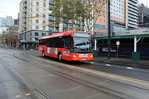 Melbourne Visitor Shuttle - Driver Bus Lines Custom Coaches bodied Denning Manufacturing on La Trobe Street in June 2013