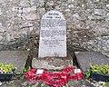 Memorial stone in Moelfre commemorating the street lighting.jpg