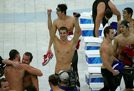 Michael Phelps celebrates with his teammates after winning his 8th gold medal. Michael Phelps wins 8th gold medal.jpg