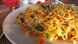 Mie goreng , Indonesian fried noodles served in Bali .
