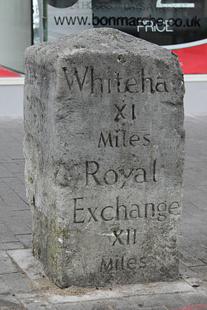 Sutton High Street - Milestone on Sutton High Street. This shows that Sutton is 11 miles by road from the administrative quarter of London (Whitehall) and 12 miles from the financial quarter (Royal Exchange)