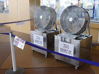 Evaporative cooler - Mist spraying system with water pump beneath