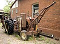 Modified Sunshine Massey Harris tractor used for fencing.jpg