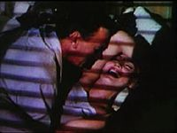 Monroe laughs while in bed with Cotten in the trailer of Niagra 1.jpg