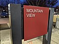 Mountain view Caltrain station sign at night.jpg