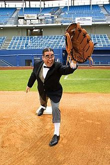 Myron Noodleman holding a large glove