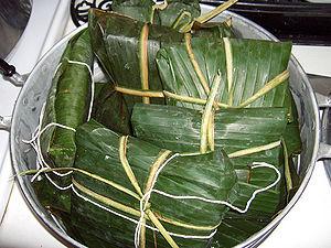 Nacatamal - Nacatamales tied in plantain leaves ready to be steamed