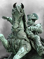 Photo of a statue of Napoleon on a horse.