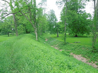Newark Earthworks - View along the main wall and the moat from the outside the Great Circle. The break in the wall - the traditional entrance - is visible in the far distance.