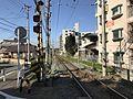Nishitetsu Kaizuka Line on north side Tonoharu Station.jpg