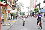 Looking north on Luis Moya Street in the historic center of Mexico City with bicyclists