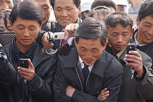 Telecommunications in North Korea - North Koreans with cellphones, April 2012
