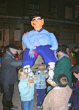 Olentzero - A figure of Olentzero being carried through the streets of Barakaldo
