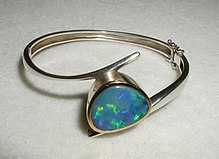 An opal armband. Opal is the birthstone for October.
