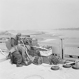 Battle of Nijmegen - British soldiers dismantle German explosives on the Waal Bridge.