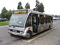 Optare Courtney Coaches bus at Didcot Station, Oxfordshire.jpg