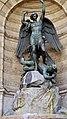 P1080345 France, Paris, détail de la fontaine de la Place Saint-Michel; on y voit la statue de saint Michel terrassant le Diable œuvre de Francisque-Joseph Duret, encadrée de deux dragons cracheurs d'eau. (5629734484).jpg
