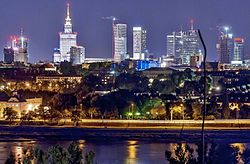 Panorama of Warsaw by night (cropped).jpg