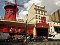 Paris, France. Moulin Rouge. Women and men are joyous to be happy.jpg