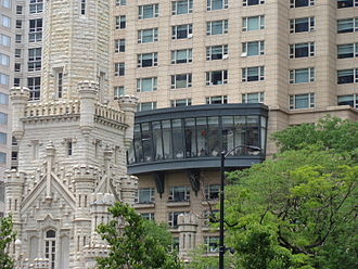 Park Tower (Chicago) - Park Tower detail - the restaurant (NoMi), Chicago Water Tower to the left