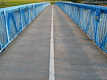 First-person perspective view, looking along the deck of the Bay Farm Island Bicycle Bridge